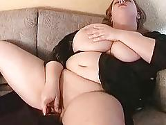 Hot big breasted MILF fatty masturbates on the sofa