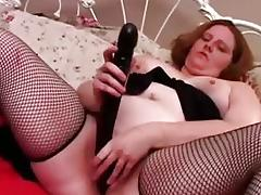 Sassy fatty in fishnets fucks a huge dildo
