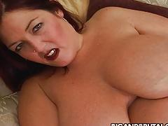 Randy redhead fat momma with big bosom masturbates on bed