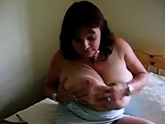 Mature milf showing her huge tits